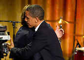 United States President Barack Obama hugs former Beatle Paul McCartney during a concert in the East Room of the White House in Washington, D.C., U.S., on Wednesday, June 2, 2010. Obama presented McCartney with the Gershwin Prize for Popular Song awarded by the Library of Congress. .Credit: Andrew Harrer / Pool via CNP
