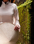 Ao Dai 05 - Vietnamese woman in traditional silk white ao dai, Hoi An, Viet Nam