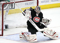 St. Cloud State goalie Mike Lee blocks a shot during the third period. UNO beat St. Cloud State 3-0 Friday night at Qwest Center Omaha.  (Photo by Michelle Bishop)