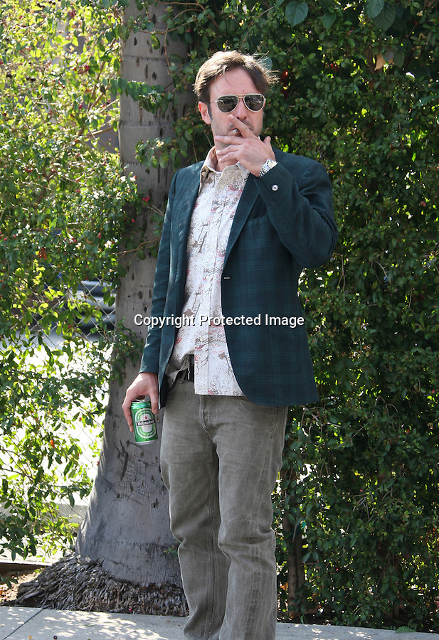 Septemeber 22nd 2010 Exclusive...David Arquette walking around Hollywood blvd & in front of the Rosevelt  Hotel drinking a Heineken beer & smoking a cigarette without a care in the world. We all know it's illegal to drink in public but that sure didn't seem to bother Mr.Arquette. I love this Guy!!..David's shoes even matched the beer he was drinking....AbilityFilms@yahoo.com.805-427-3519.www.AbilityFilms.com.