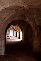 A view along the undercroft with its gothic sandstone vaulting
