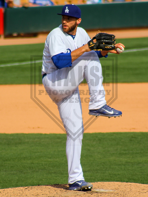 GLENDALE - March 2015: Paco Rodriguez (75) of the Los Angeles Dodgers during a spring training game against the Cleveland Indians on March 17th, 2015 at Camelback Ranch in Glendale, Arizona. (Photo Credit: Brad Krause)