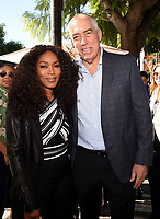 HOLLYWOOD, CALIFORNIA - DECEMBER 4: Angela Bassett and Chairman and CEO Fox Television Group Gary Newman attend a ceremony honoring Ryan Murphy with a star on The Hollywood Walk of Fame on December 4, 2018 in Hollywood, California. (Photo by Frank Micelotta/Fox/PictureGroup)