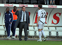Pictured: Brendan Rodgers manager of Swansea City shakes hands with Angel Rangel. Saturday 17 September 2011<br /> Re: Premiership football Swansea City FC v West Bromwich Albion at the Liberty Stadium, south Wales.