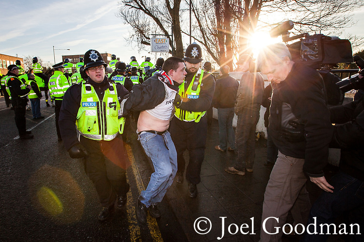 © Joel Goodman - 07973 332324 . 11/12/2010 . Peterborough , UK . Police detain a man at the demonstration . The English Defence League ( EDL ) hold a demonstration in Peterborough . Photo credit : Joel Goodman