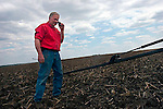 Craig Griffieon on the phone at planting time, Griffieon Family Farm, Ankeny, Iowa.