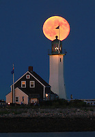 Scituate, MA  -  The moon rises over Scituate Lighthouse on Saturday, September 1, 2012.