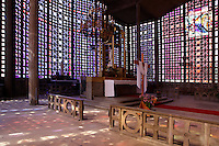 Low angle view of the altar and altar rail surrounded by stained glass windows in the nave of the church of Notre-Dame du Raincy on May 24, 2009 in Le Raincy, Seine Saint Denis, France. Built in 1922-1923 by the architects and brothers Auguste and Gustave Perret, the cathedral was the first one to be built with reinforced concrete. The stained glass was created by Marguerite Hure based on sketches by Maurice Denis. Picture by Manuel Cohen