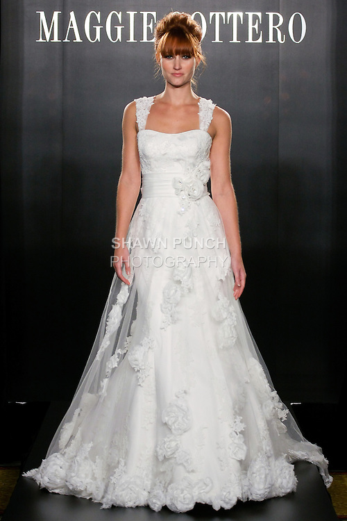 Model walks the runway in an Olivia Haute Couture wedding dress from the Maggie Sottero Bridal Spring 2012 collection, during  Couture: New York Bridal Fashion Week 2012
