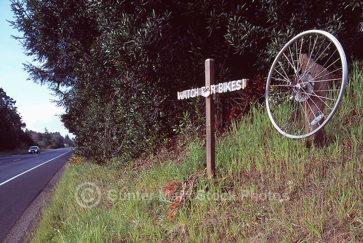 Cross and Bike Wheel Roadside Memorial dedicated to Victim of Deadly Bicycle Accident on Highway