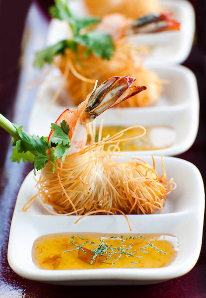 Goong Sarong, Shrimp Tapas at Six Senses Hideaway Yao Noi, Koh Yao Noi, Thailand. Deep fried shrimps wrapped with Phuket noodles and sweet chili sauce, a Thai tapas dish created by Executive Chef Marcus Hume.