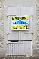 For Sale sign on period property at Serigny in the Loire Valley, France