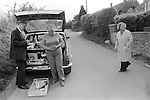 Upper Basildon, Berkshire. 1983<br /> The local Methodist lay preacher deliveries pre-ordered groceries once a week from the back of his car. The village shop had recently closed down.