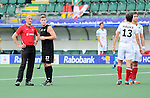 The Hague, Netherlands, June 08: Stephen Jenness #27 of New Zealand and the umpire watch the replay on the large video screen during the field hockey group match (Men - Group B) between the Black Sticks of New Zealand and Germany on June 8, 2014 during the World Cup 2014 at Kyocera Stadium in The Hague, Netherlands.  Final score 3-5 (1-3) (Photo by Dirk Markgraf / www.265-images.com) *** Local caption ***
