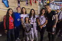 PASADENA, CA - AUGUST 4: Megan Rapinoe #15 and Ashlyn Harris #18 pose with the family of Gianni Infantino during a game between Ireland and USWNT at Rose Bowl on August 3, 2019 in Pasadena, California.