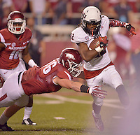 STAFF PHOTO BEN GOFF  @NWABenGoff -- 09/20/14 <br /> Arkansas defender Alex Voelzke tries to tackle Northern Illinois wide receiver Aregeros Turner on a kickoff return during the fourth quarter of the game in Reynolds Razorback Stadium in Fayetteville on Saturday September 20, 2014.