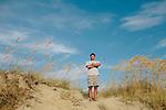 Mark Dodd, DNR Sea Turtle Program Coordinator, stands for a portrait on the beach of Jekyll Island, Georgia at dawn August 15, 2013.