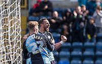 Paul Hayes of Wycombe Wanderers celebrates his goal with Jason McCarthy of Wycombe Wanderers during the Sky Bet League 2 match between Wycombe Wanderers and Barnet at Adams Park, High Wycombe, England on 16 April 2016. Photo by Andy Rowland.