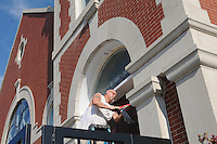 NWA Democrat-Gazette/FLIP PUTTHOFF<br /> Randy James applies caulk while working Tuesday Sept. 15 2015 at First United Methodist Church in downtown Rogers. James was caulking and painting at the historic church located at 307 W. Elm St.