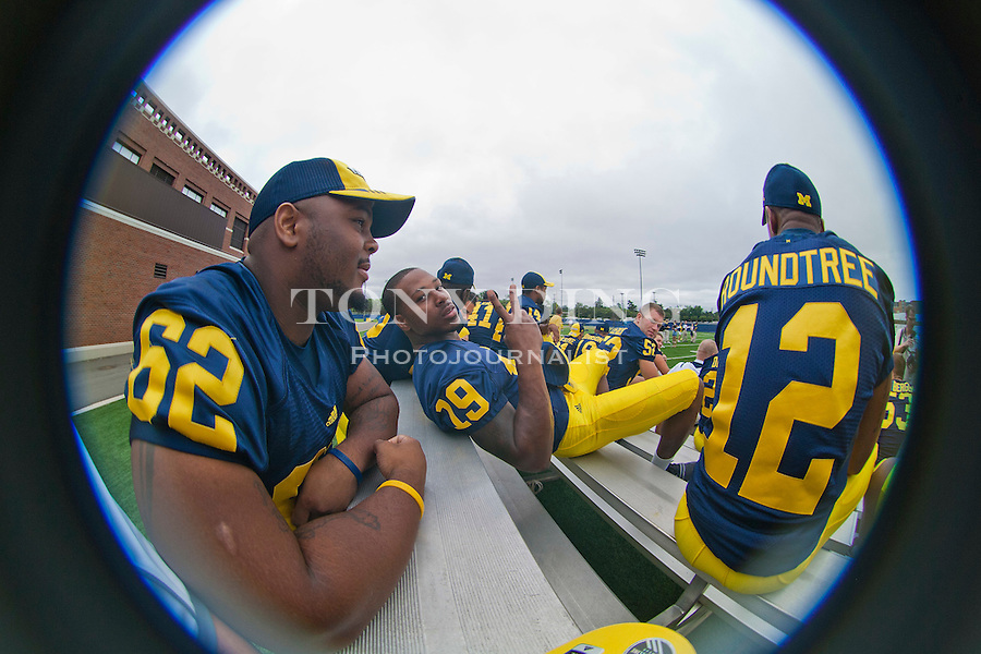 Michigan wide receiver Kelvin Grady (19) poses for a picture, as he relaxes with defensive tackle Dominique Ware (62) and wide receiver Roy Roundtree (12), at the annual NCAA college football media day, Sunday, Aug. 22, 2010, in Ann Arbor, Mich. (AP Photo/Tony Ding)