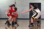 Palos Verdes, CA January 19, 2010 - Victoria Yutronich (32) and Shelby Tsukamoto (11) in action during the Palos Verdes vs Peninsula Panthers basketball game at Peninsula High School.