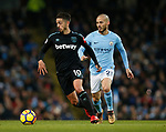 Manuel Lanzini of West Ham United gets in front of David Silva of Manchester City during the premier league match at the Etihad Stadium, Manchester. Picture date 3rd December 2017. Picture credit should read: Andrew Yates/Sportimage