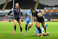Dan Evans of Ospreys is tackled by Nick Grigg of Glasgow Warriors during the Guinness Pro14 Round 8 match between the Ospreys and Glasgow Warriors at the Liberty Stadium in Swansea, Wales, UK. Friday 2nd November 2018