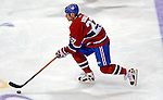 6 February 2007: Montreal Canadiens right wing forward Alexei Kovalev of Russia carries the puck up ice against the Carolina Hurricanes at the Bell Centre in Montreal, Canada. The Hurricanes went on to defeat the Canadiens 2-1.....Mandatory Photo Credit: Ed Wolfstein *** Editorial Sales through Icon Sports Media *** www.iconsportsmedia.com