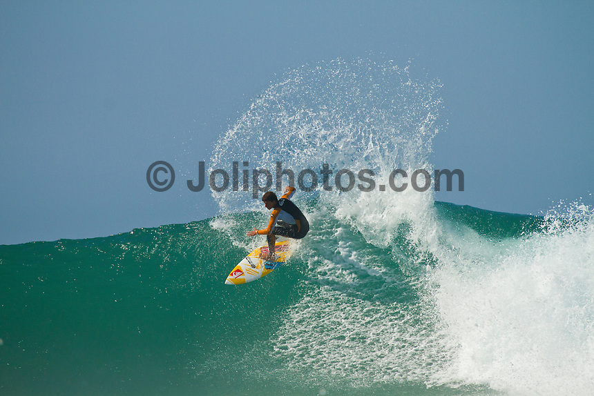 Monday July 26, 2010. Maxime Huscenot (REU) free surfing at Supertubes, Jeffreys Bay, Eastern Cape, South Africa.  Photo: joliphotos.com