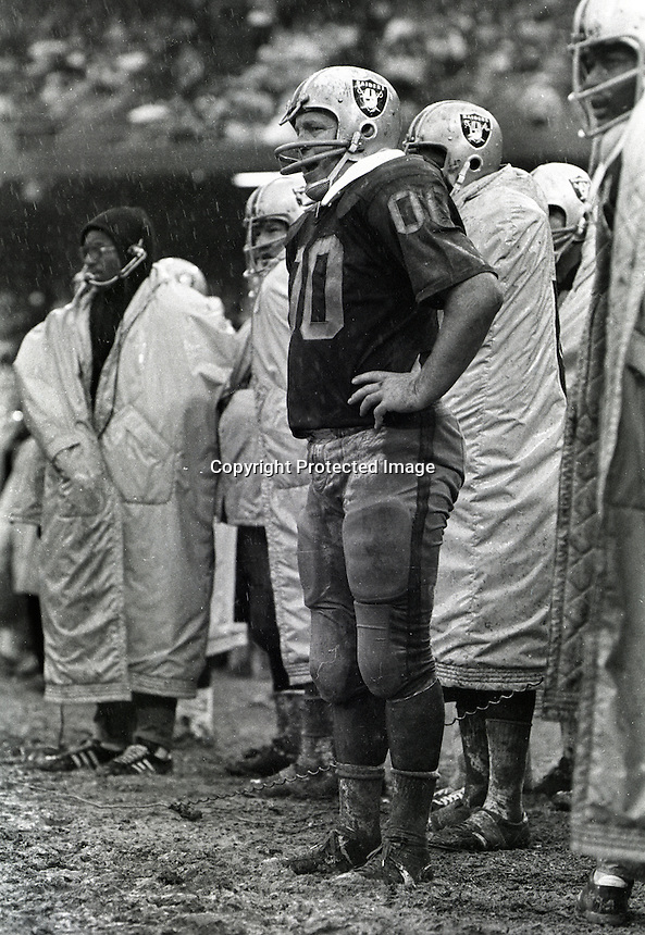 Raider center Jim Otto standing in the mud. .(photo copyright Ron Riesterer 1970)