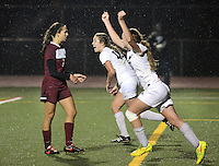 Central Bucks South's Corinne McDonald (center) and Mackenzie Edwards (right) celebrate a goal in the second half of a District One Class AAAA playoff soccer game as West Chester Henderson's Katie Holmes walks past them Thursday, October 27, 2016, 2016 at Central Bucks South High School in Warrington, Pennsylvania. (WILLIAM THOMAS CAIN / For The Philadelphia Inquirer)