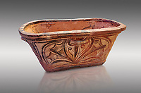 Minoan  pottery bath tub larnax decorated with a stylised crocus flower ,  Episkopi-Lerapetra 1350-1250 BC, Heraklion Archaeological  Museum, grey background.<br /> <br /> To the Greeks, the Underworld was entered by water. As with many other Minoan bathtubs, this one was probably later used as a coffin to convey the deceased across the sea, where marine imagery would be equally appropriate. The two functions of bathtubs, bathing and burial, combine in the story of Agamemnon who, on return from Troy, was murdered by his wife and her lover in a silver bath.