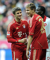 FUSSBALL   1. BUNDESLIGA  SAISON 2011/2012   11. Spieltag FC Bayern Muenchen - FC Nuernberg        29.10.2011 Thomas Mueller , Holger Badstuber (v. li., FC Bayern Muenchen)