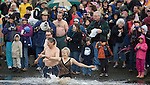 After a canon is fired, participants in the 26th annual Polar Bear rush into the Burley Lagoon in Olalla, Washington on 1 January  2010. Over 300 hardy participants  braved the chilly lagoon waters to join in on the annual New Year's Day Tradition.  Jim Bryant Photo. ©2010. ALL RIGHTS RESERVED.