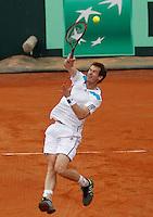 Britain's Andy Murray  ( L)   during their Davis Cup quarter-final doubles tennis match against Italy's Fabio Fognini  Simone Bolelli in Naples April 5, 2014.