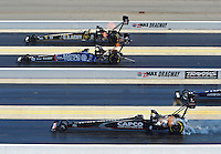 Apr. 14, 2012; Concord, NC, USA: NHRAtop fuel dragster drivers (top to bottom) Tony Schumacher , Antron Brown and Steve Torrence race during qualifying for the Four Wide Nationals at zMax Dragway. Mandatory Credit: Mark J. Rebilas-