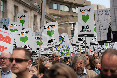 A forest of placards is held aloft at the Climate Change demonstration, London, 21st September 2014. © Sue Cunningham