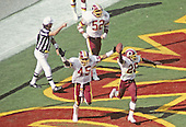 Washington Redskins cornerbacks Darrell Green (28) and Barry Wilburn (45) celebrate Green's interception of a pass during the game against the Los Angeles Raiders at RFK Stadium in Washington, D.C. on September 14, 1986.  The Redskins won the game 10 - 6.<br /> Credit: Arnold Sachs / CNP