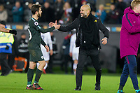 Manchester City manager Pep Guardiola congratulates Bernardo Silva of Manchester City at full time of the EPL - Premier League match between Swansea City and Manchester City at the Liberty Stadium, Swansea, Wales on 13 December 2017. Photo by Mark  Hawkins / PRiME Media Images.