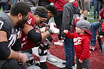 Cougar fans get autographs from their favorite players following the 2019 Spring Game in Pullman, Washington.