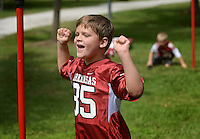 NWA Democrat-Gazette/BEN GOFF @NWABENGOFF<br /> Hayden Alpe, 7, of Fayetteville celebrates a point while playing games with friends on Saturday Sept. 19, 2015 while tailgating before the Arkansas football game against Texas Tech in Fayetteville.