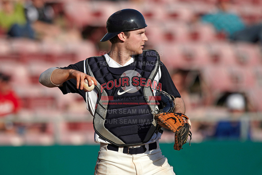 Illinois Fighting Illini catcher Kelly Norris-Jones #4 during a game against the Louisville Cardinals at the Big Ten/Big East Challenge at Al Lang Stadium on February 18, 2012 in St. Petersburg, Florida.  (Mike Janes/Four Seam Images)
