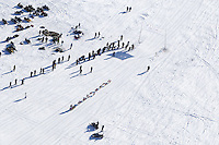 DeeDee Jonrowe passes spectators on Long Laek in Willow, Alaska duirng the re-start of the 2011 Iditarod.