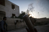 In this Tuesday, Oct. 08, 2013 photo, a launcher smokes after shot rounds of mortar artillery during an attack over Wadi Al-Deef military post at the frontline in Maraat Al-Nouman in the Idlib province countryside of Syria. (AP/Photo)