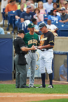 Lynchburg Hillcats manager Mark Budzinski (7), Wilmington Blue Rocks manager Jamie Quirk (9), and umpire Chris Scott go over the lineup after Austin Bailey (not shown) batted out of order on June 3, 2016 at Judy Johnson Field at Daniel S. Frawley Stadium in Wilmington, Delaware.  Lynchburg defeated Wilmington 16-11 in ten innings.  (Mike Janes/Four Seam Images)