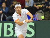 04-03-11, Tennis, Oekraine, Kharkov, Daviscup, Oekraine - Netherlands, Robin Haase  hits the ball halfway his racket