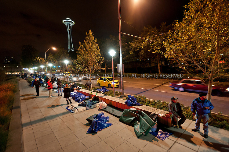 10/12/2011--Seattle, WA, USA..Homeless in Seattle, organized by SHARE (Seattle Housing and Resource Effort), camp outside the Bill and Melinda Gates Foundation in Seattle, WASH. SHARE runs 15 shelters in Seattle and says cuts in government funding have forced it to close the shelters and put 300 people onto the street. The 'sleepout' at the Gates Foundation started on Monday, Oct. 10th, with about 50 homeless camping out with blankets and tarps; SHARE organizers have asked the Gates Foundation for funds to support its local efforts to fight homelessness and reopen the closed shelters....©2011 Stuart Isett. All rights reserved.