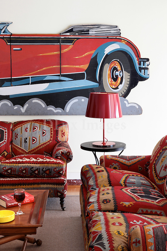 living room with antique car decoration
