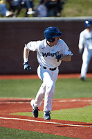 Mitch Farris (15) of the Wingate Bulldogs hustles down the first base line against the Concord Mountain Lions at Ron Christopher Stadium on February 2, 2020 in Wingate, North Carolina. The Mountain Lions defeated the Bulldogs 12-11. (Brian Westerholt/Four Seam Images)