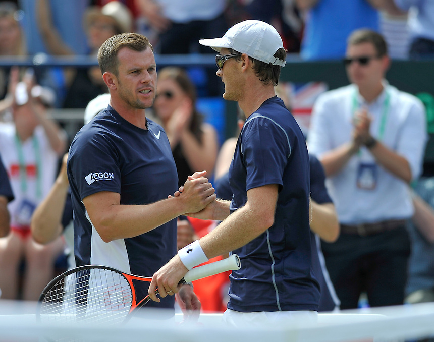 Captain Leon Smith congratulates Jamie Murray during the doubles match against Nicolas Mahut and Jo-Wilfried Tsonga<br /> <br /> Photographer Ashley Western/CameraSport<br /> <br /> International Tennis - 2015 Davis Cup by BNP PARIBAS - World Group Quarterfinals - Great Britain v France - Day 2 - Saturday 18th July 2015 - Queens Club - London<br /> <br /> &copy; CameraSport - 43 Linden Ave. Countesthorpe. Leicester. England. LE8 5PG - Tel: +44 (0) 116 277 4147 - admin@camerasport.com - www.camerasport.com.